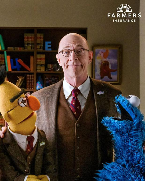 photo of JK Simmons and Sesame Street characters