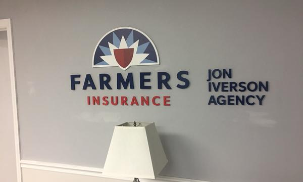 Farmers Insurance Jon Iverson Agency sign on a wall.