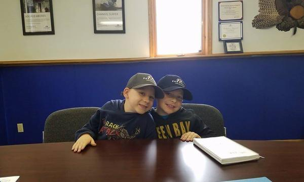 Jacob & Bryce helping dad at the office.