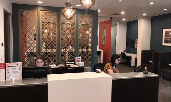 Two women sitting at the front desk of Farmers Insurance Tim Wall Agency