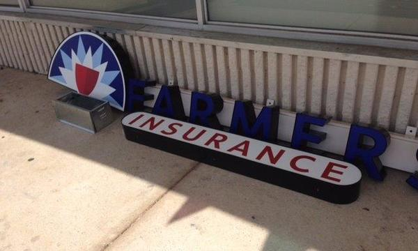 Office Farmers Insurance on the street before it has been assembled and hung