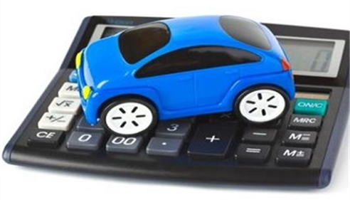 A blue toy car on top of a calculator