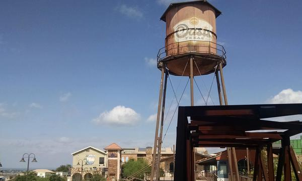 A water tower and the skyline of Oasis Texas.