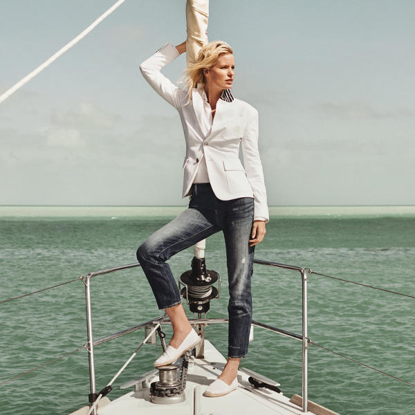 Woman with white blazer and jeans while sailing