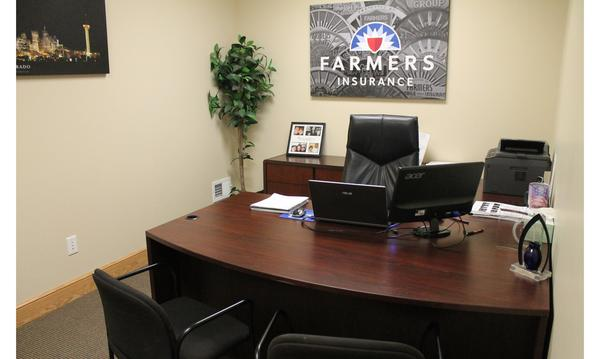 Agent's desk with Farmers sign