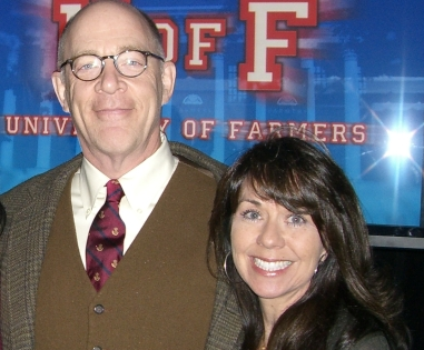Agent posing with Farmers spokesperson, J.K. Simmons.