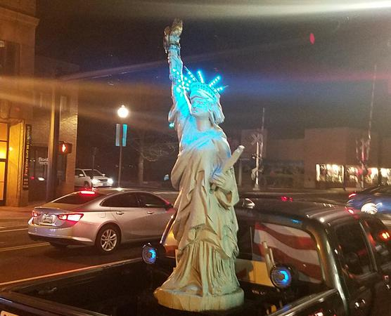 Car with statue of liberty decoration