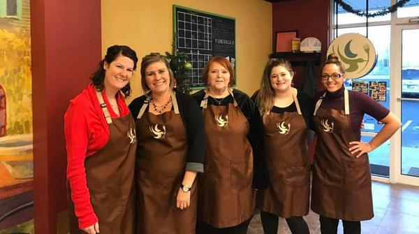 five people in brown aprons
