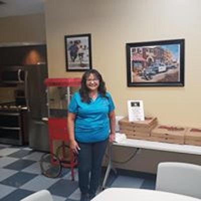 Lupe Laird in the Potter County Sheriff's Admin Building serving lunch