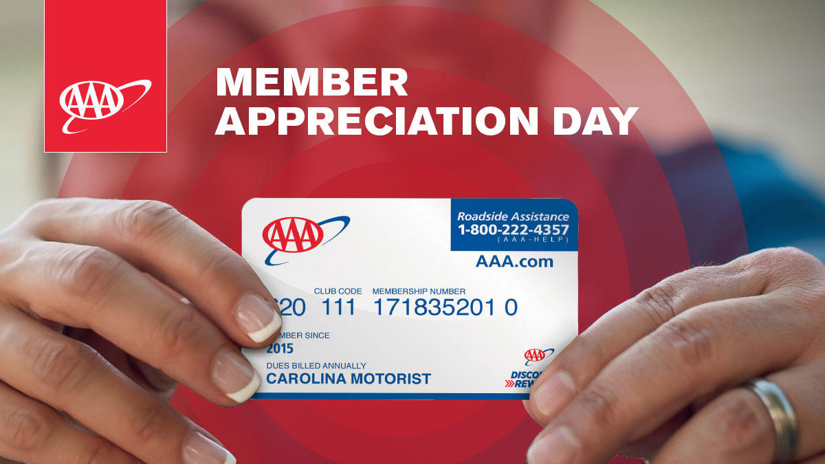 Man and Woman holding AAA card