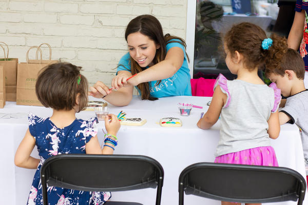 Woman crafting with children