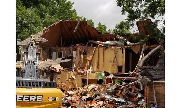 A photo of a building demolition.