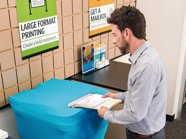 Customer placing documents in shredding bin