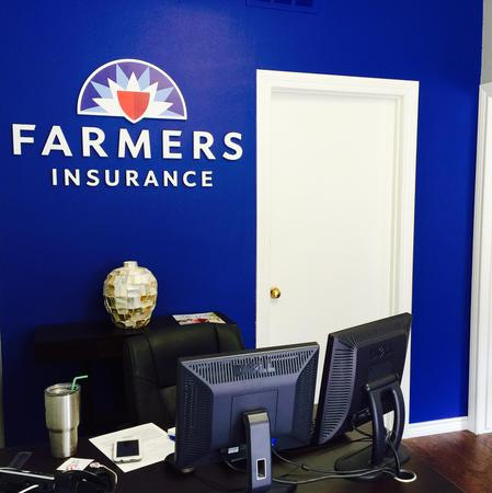 front desk with the farmers logo on the wall