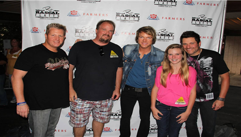 Backstage at the Rascal Flatts concert with my daughter at her first concert.