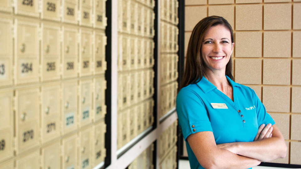 Employee standing in front of center mailboxes