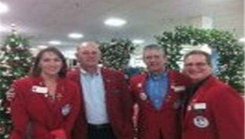 Four people wearing red jackets