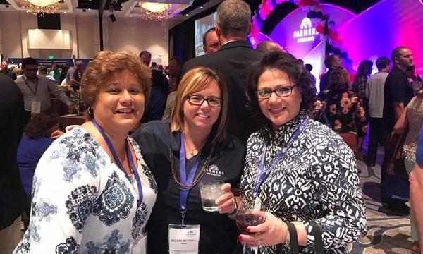 3 Farmers Insurance agents at a conference in Texas