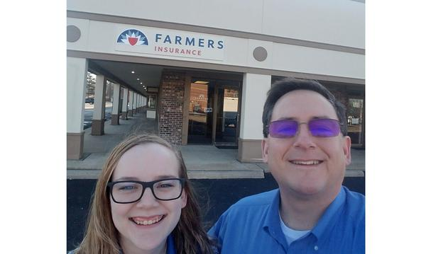 Agent Watt and girl smiling outside front of Farmers Agency