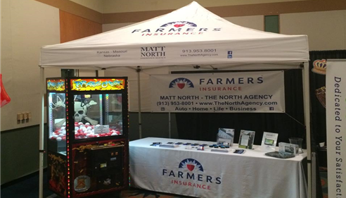 Matt North Agency's Farmers Insurance branded booth at a trade show.