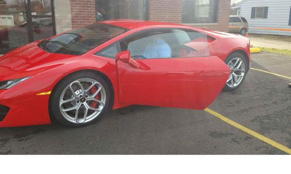 A red Lamborghini in a parking lot