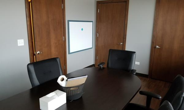 conference room with two chairs and a table