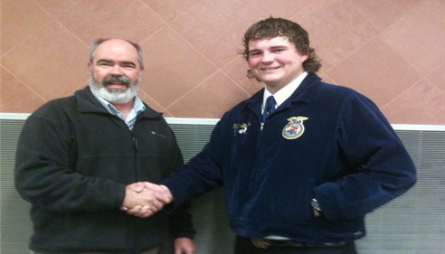 Brent congratulates a winner of an FFA competition at Bear River HS.