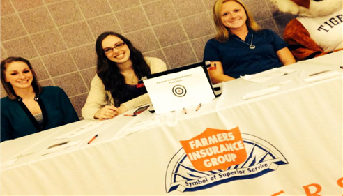 Hard at work representing Justice Insurance Agency at a local basketball game!