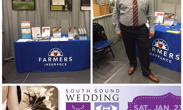 farmers booth with information and agent in front