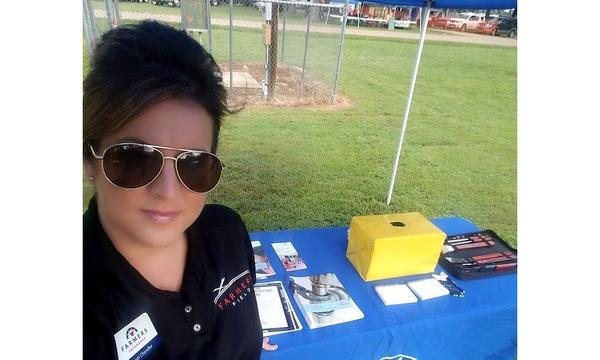 Agent Ruth at a booth at the Pine Tree Festival.