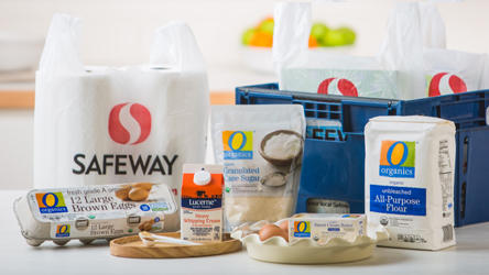Safeway grocery bags and groceries such as eggs, flour and cream.