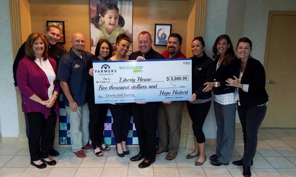 Check presentation to the Liberty House from the Golf Classic Fundraiser 2016