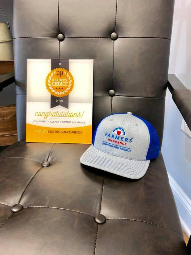 A farmers hat and a certificate sitting on a desk chair