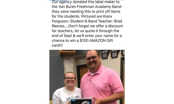 Photo of Student & Band Teacher receiving school supplies.