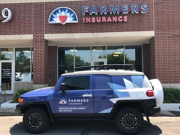 Car with Farmers logo parked outside of a Farmers agency
