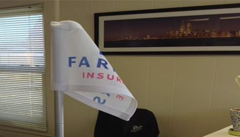 Flag with the Farmers logo on it