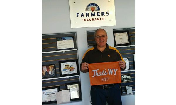 Photo of agency member holding WY sign