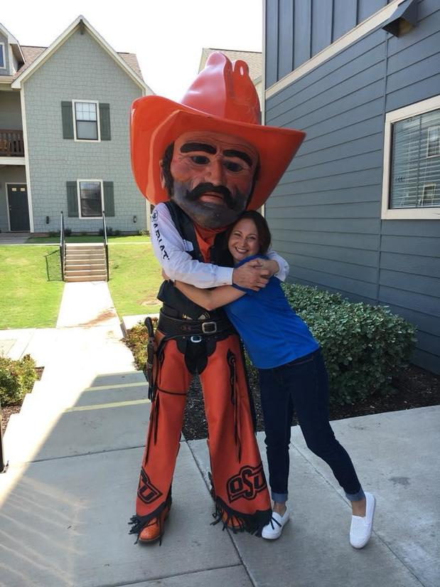 photo of person with pistol pete mascot