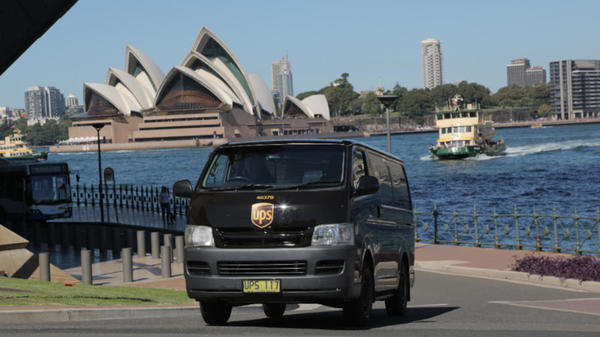 ups delivery truck in front of Sydney, Australia's Opera House
