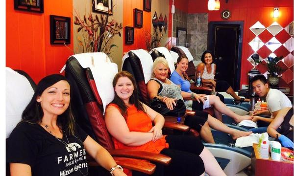 Agent Tara with 4 female staff members sitting in spa chairs.