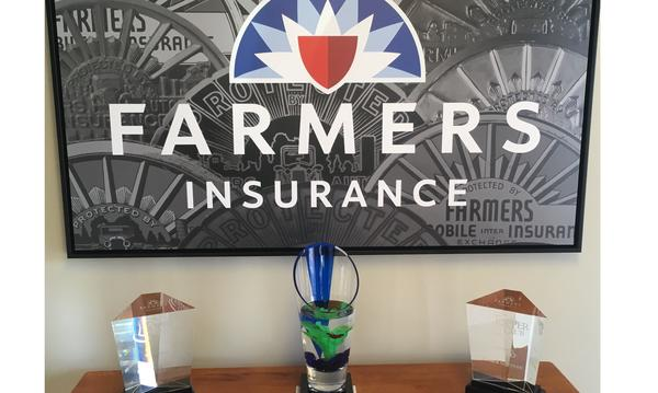 A photo of three Farmers trophies - two Topper Club trophies and a Blue Vase award