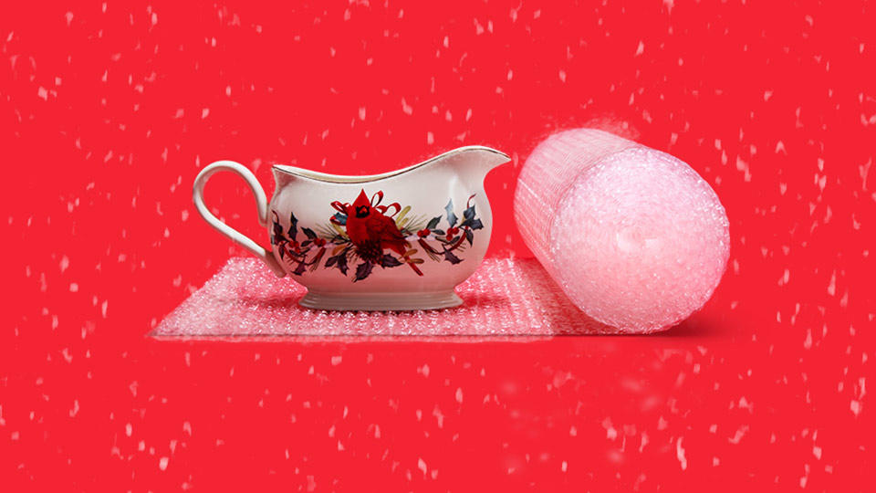 Fragile porcelain gravy boat wrapped in bubble wrap