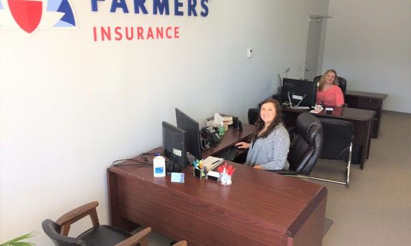 Employees at their desks at Farmers Insurance agency