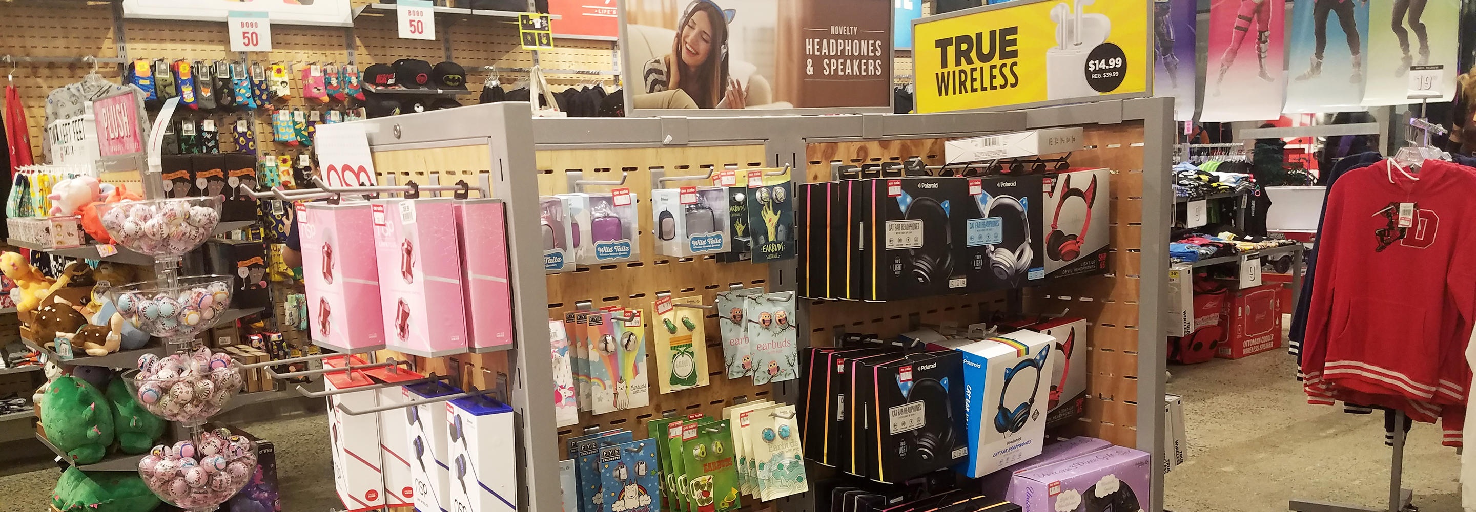 Electronics section featuring headphones and earbuds in FYE