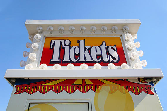 tickets sign outside of an amusement park