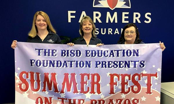 3 women holding a summerfest sign.