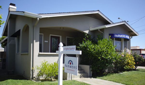 Farmers® Insurance office with yard sign
