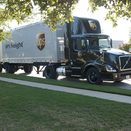 ups freight shipping semi-truck parked on the street