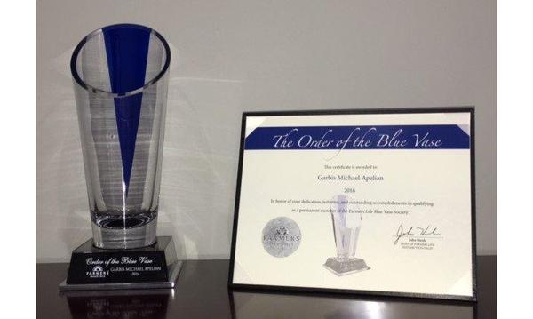 glass blue vase trophy and certificate for the blue vase award