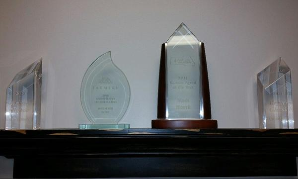 Four awards on a shelf.